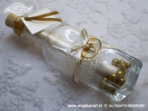 pozivnica u boci sa zlatnim prstenima i mašnicom