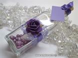 pozivnica u boci za vjenčanje s ljubičastom ružom